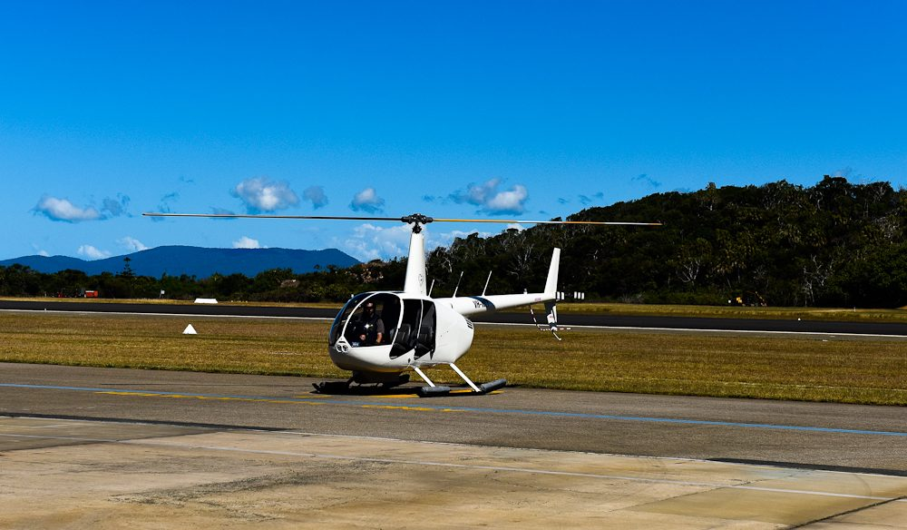 Three photographers, one pilot, ready to take off over the Whitsundays.