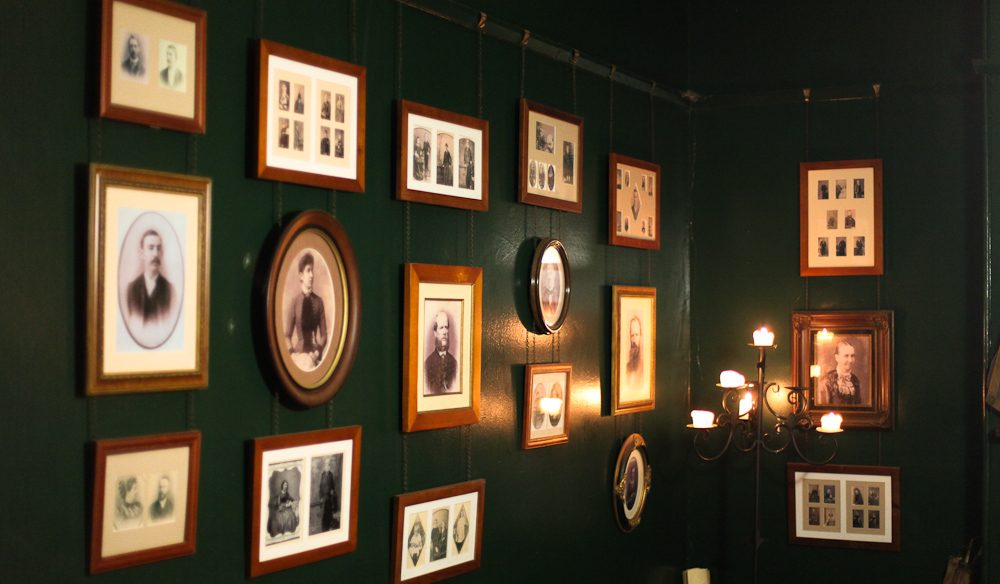 The Parlour room featuring original photographic portraits, photo by Sam Griffith
