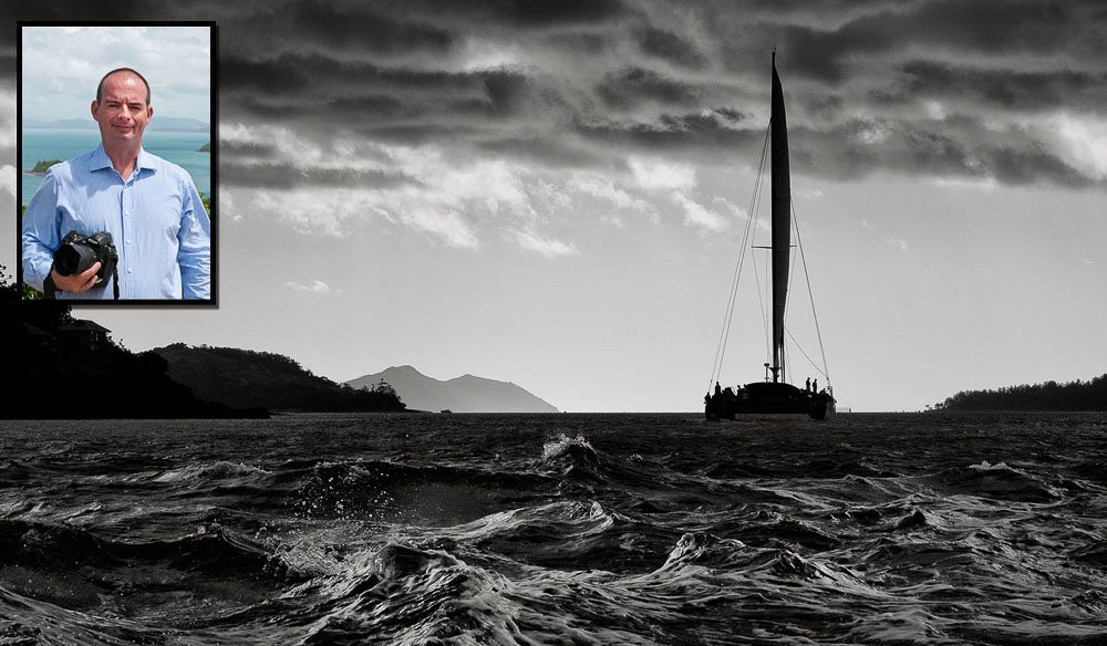 Hamilton Island GM Ciaran Handy and one of his photographs: dark and stormy, The Whitsundays.