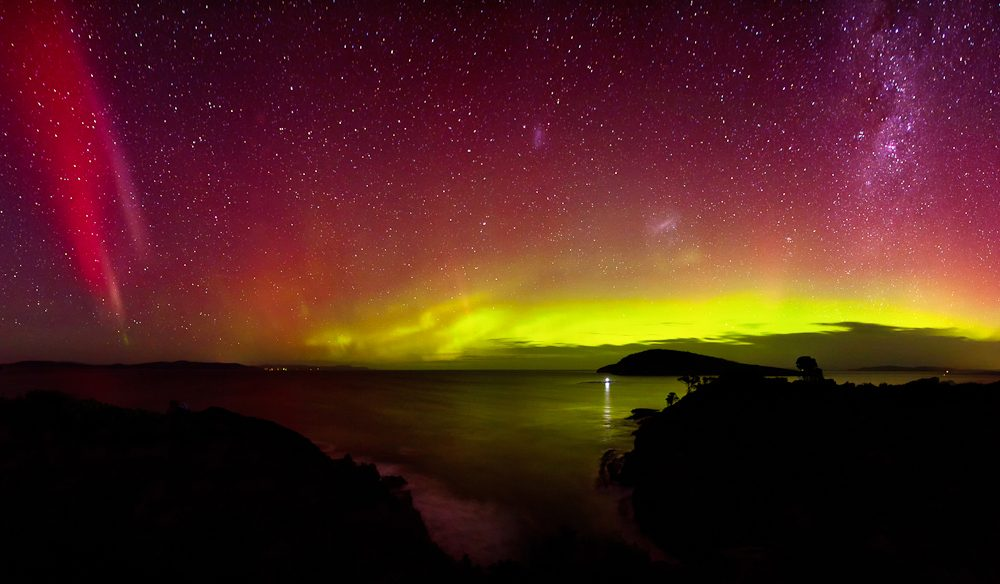 The Southern Lights (Aurora Australis) shines from Goats Bluff, Tasmania (Photo: James Garlick)