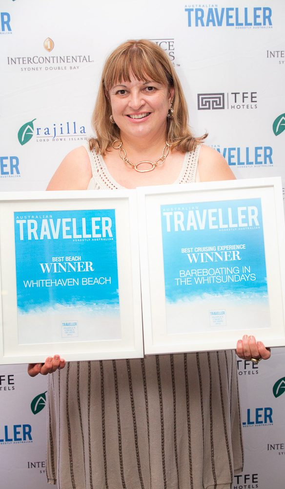 Kerri Anderson Global PR Manager Tourism Queensland accepts two People's Choice Awards 2014 for Best Cruising Experience for Bareboating in the Whitsundays and Best Beach for Whitehaven beach