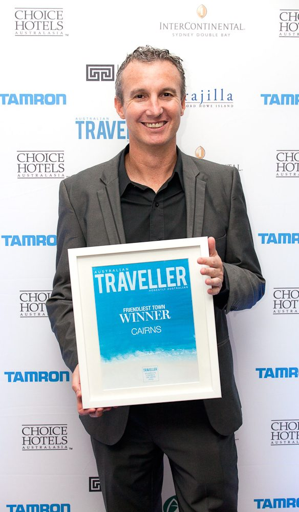Dale Flack Media and Consumer Marketing Manager Of Tourism Tropical North Queensland accepts the award for the Friendliest Town, Cairns.