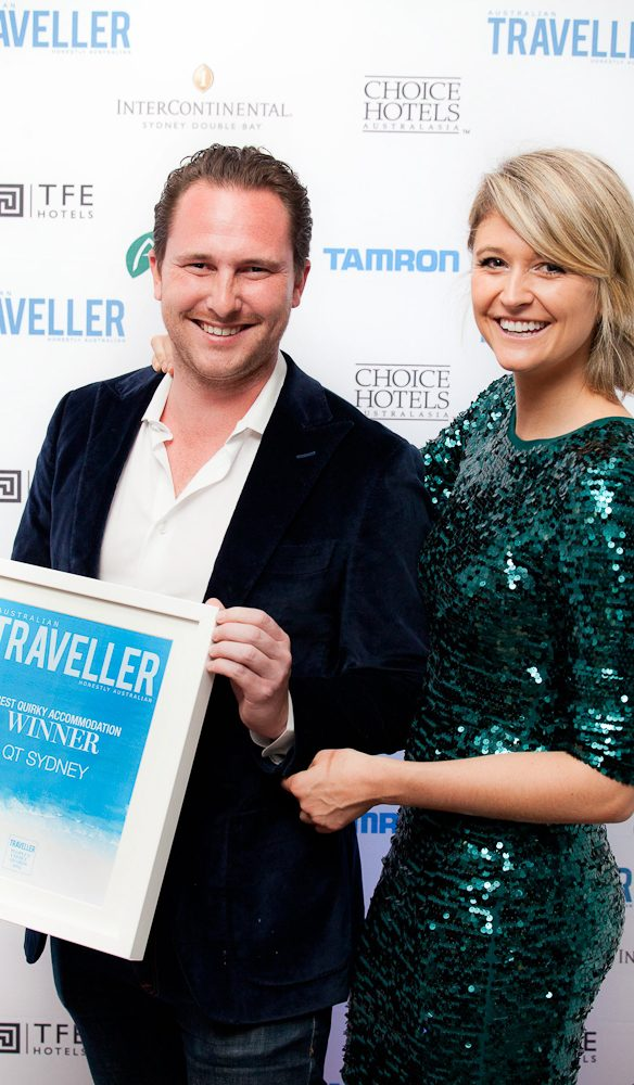 Stephen Howard, Group PR and Promotions Manager at Amalgamated Holdings, with Georgia Rickard, editor Australian Traveller magazine accepting the award for Best Quirky Accommodation QT Sydney.