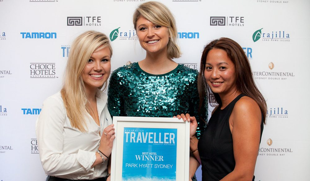 Sarah Endres Sales and Marketing Coordinator Park Hyatt Sydney (left) and Maryan Awang Marketing Communications Manager Park Hyatt Sydney (right) accepting the People's Choice Award 2014 for Best Hotel from editor Australian Traveller Georgia Rickard.