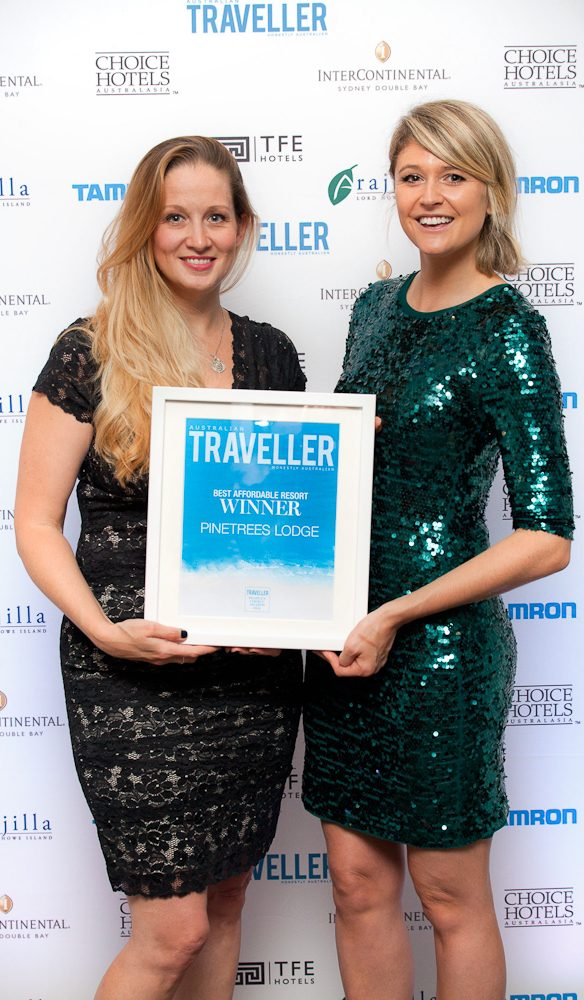 Tennille Schell General Manager Pinetrees Lord Howe Island Travel receives the People's Choice Award 2014 for Best Affordable Resort from Australian Traveller editor Georgia Rickard.