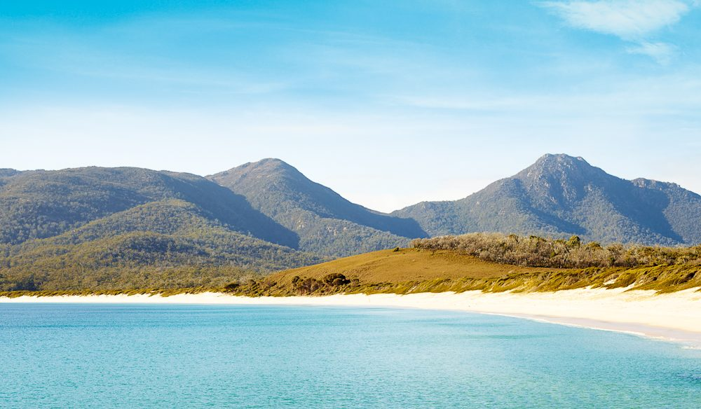 The entire east coast abounds in beautiful beaches, from the wide solitude of Kelvedon Beach with its grazing sheep and rustic ruins to breathtaking sweep of Wineglass Bay. (photo: Max Doyle)