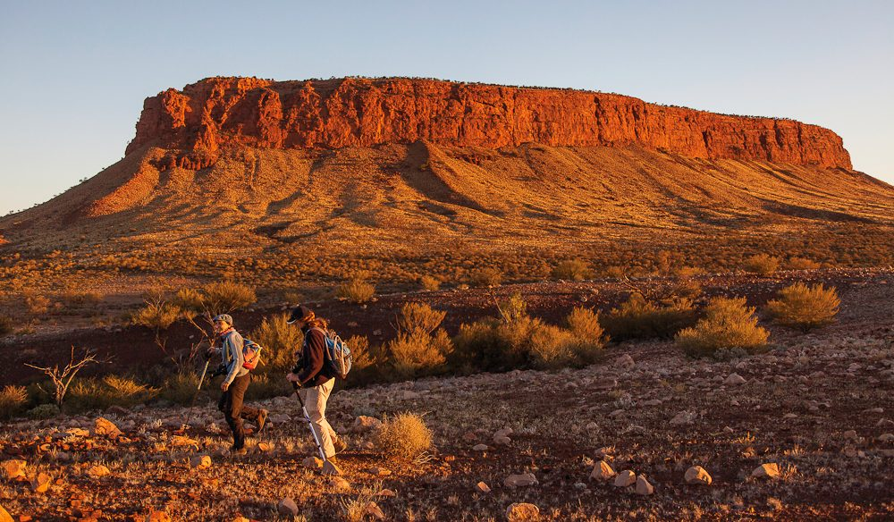 Walking to Mt Conner at Curtin Springs Station (photo: Tourism NT).