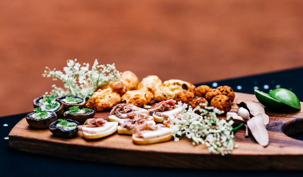 Sunset canapes spread at the base of the rock for Longitude 131 guests (photo: Elise Hassey).