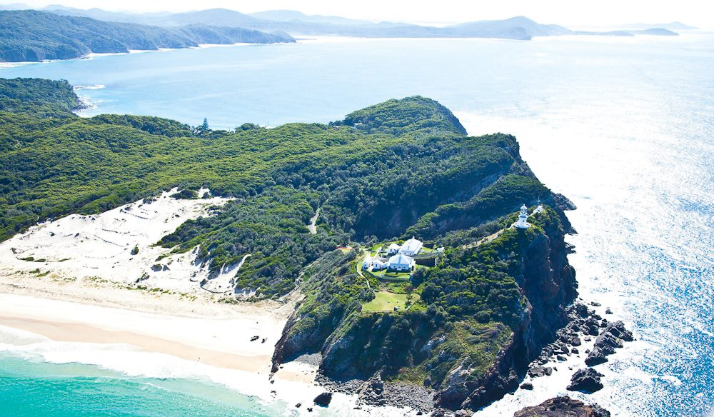 Yes, you can stay at Sugarloaf Point Lighthouse, Seal Rocks.
