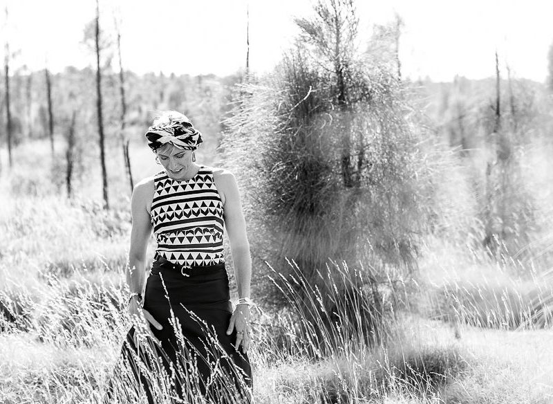 Black and white Claudia Karvan in the outback.