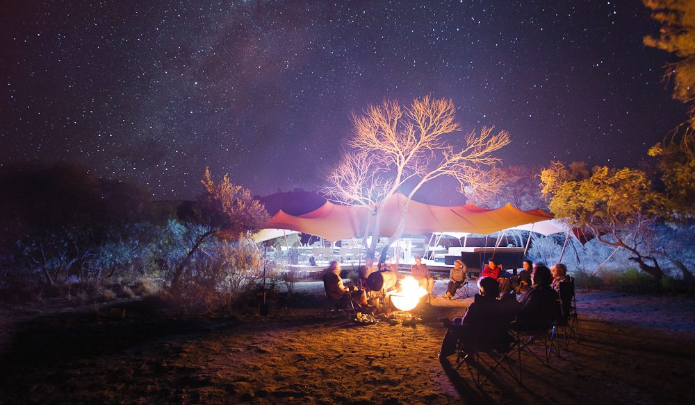 Campfire stories drift into the outback sky after a hard day's trek on the Larapinta (photo: Graham Freeman).