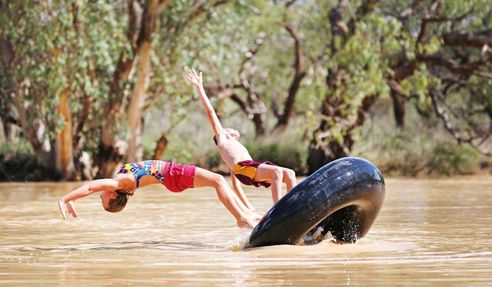 Local children employ a truck tube to make the most of a flooded Bulloo River (photo: Nathan Dyer).