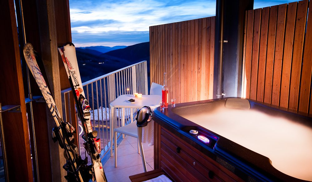 Apres skiing on your own balcony in a private hot tub, QT Falls Creek.