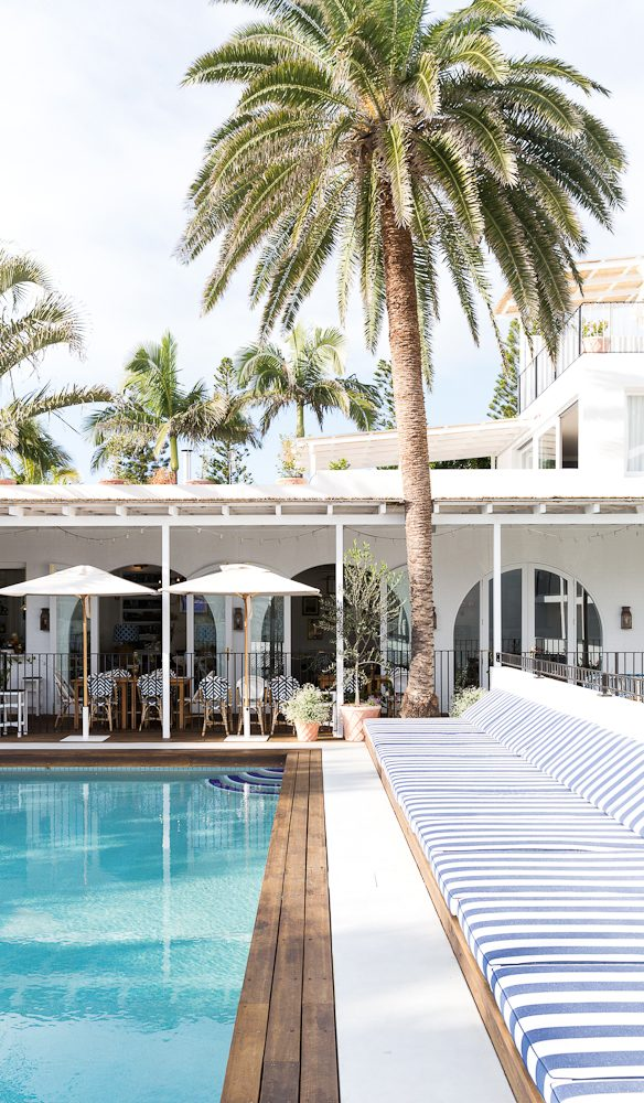 The blue and white sun beds and decking set the pool off perfectly (Photo: Peter Tarasiuk).