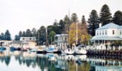 Boats hug Port Fairy's pretty wharf