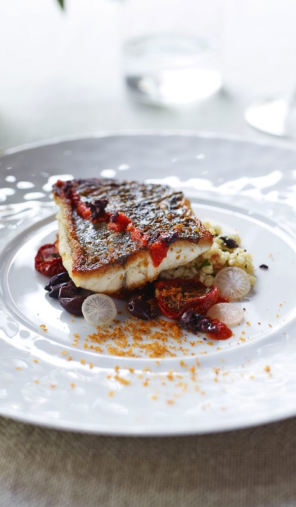 Pan fried mulloway with fregola sarda, tomato and olive by Stefano Manfredi.