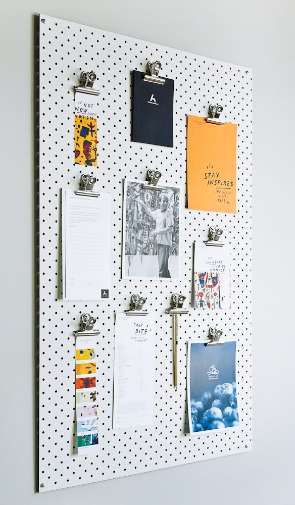 You'll find typical hotel amenities information and things to do on an artist-style hardboard.