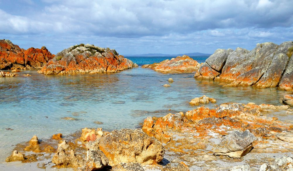 Unmistakable orange granite boulders of Tasmania's Bay of Fires.