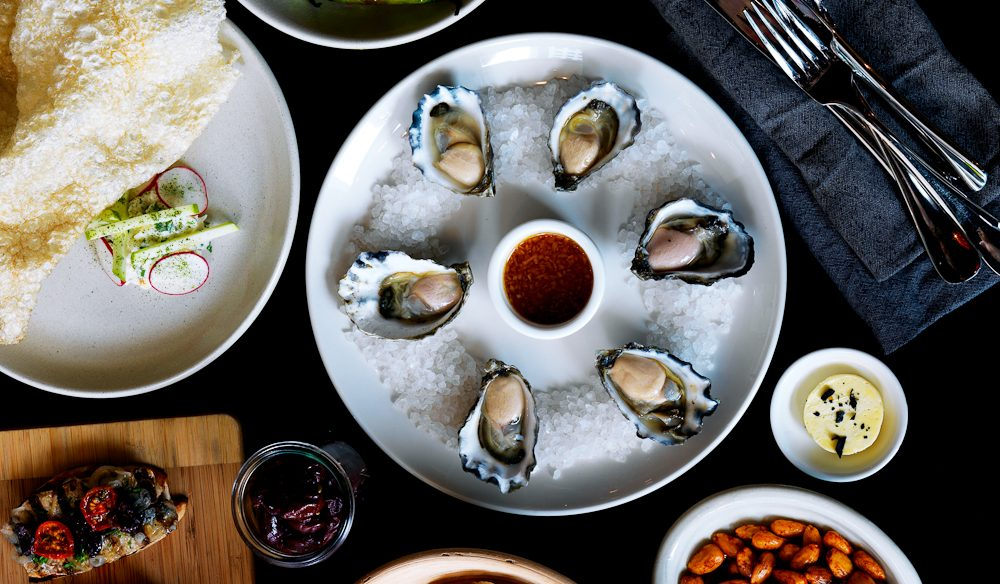 Wood-fired tapas and oysters await you at Temporada.