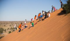 Sliding fun on Big Red dune (photo: Benjamin Knight).