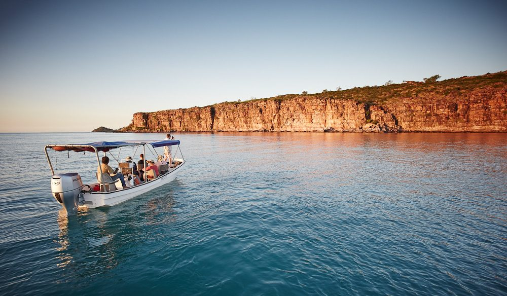 A boat ride from Faraway Bay to see the spectacular cliff-faced coast of the Kimberley (photo: Ewan Bell).