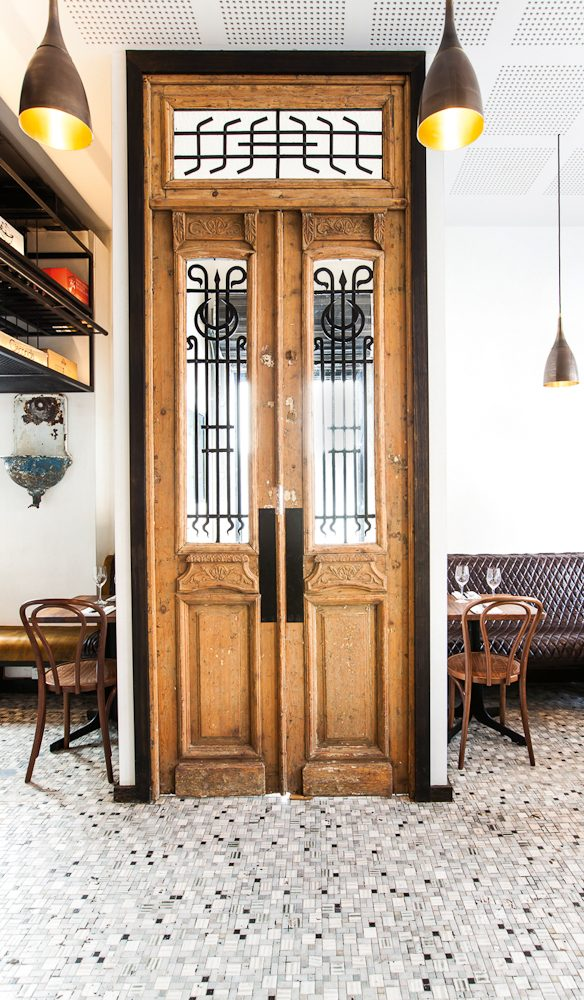 Victorian-style doors provide a bold entrance.