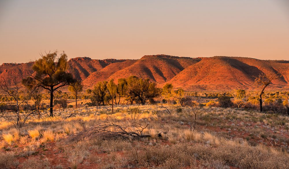 The sun sets at George Gill Ranges.