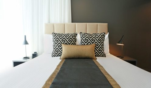 One of the contemporary bedrooms inside the Alex Perry Hotel & Apartments.