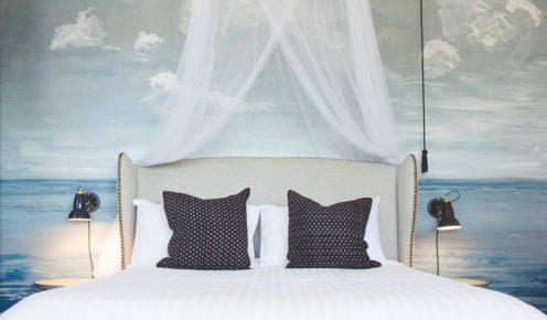 Murals by Neil Mallard adorn Hotel Palisade's space.