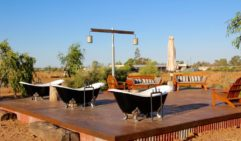 Bathe underneath the stars while staying at Kinnon & Co in Longreach.
