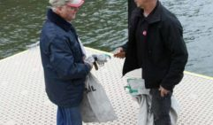 You've got mail!; river postie Adam Millward hands Bar Point resident Tony Bird his mail  (photo: Jennifer Ennion).