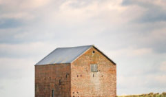 A restored warehouse rises on Maria Island, Tasmania (photo: Nathan Dyer).
