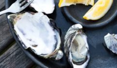 Just a squeeze of lemon is all you need to flavour these plump oysters. Bruny Island (photo: Peter Tarasiuk).