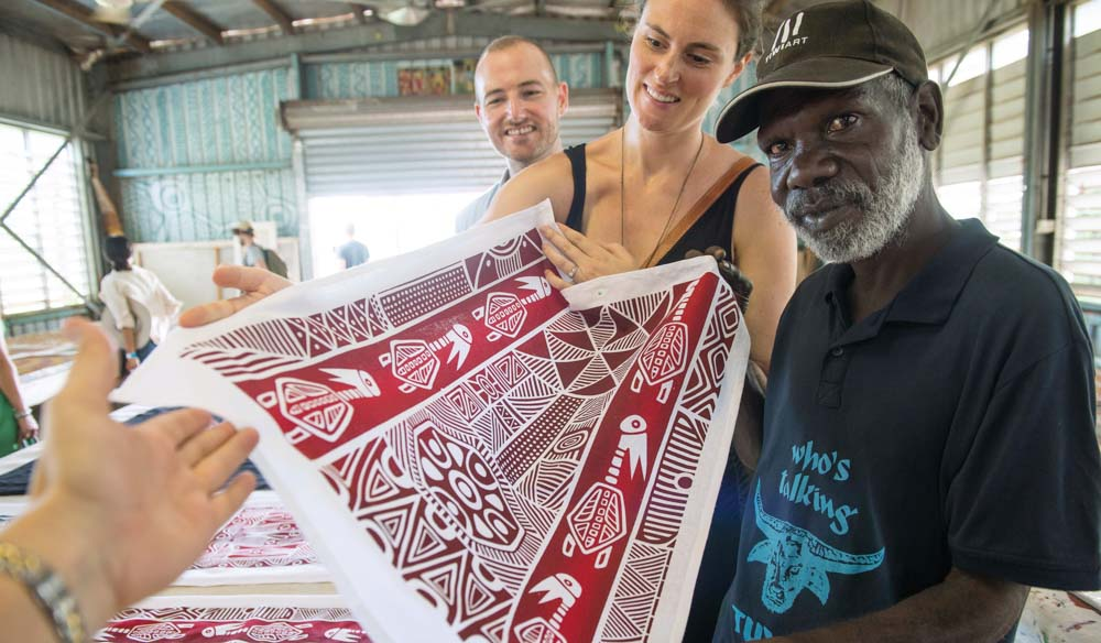 A couple shop for art at the Tiwi Islands Art Sale. Northern Territory.