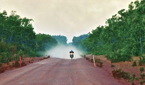 The motorbike rider leaves a trail of dust behind him as he embarks on an adventure from Cape York to Cairns (photo: Ian Neubauer).