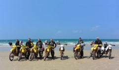 Posing for a team shot on a beach near Cape York.