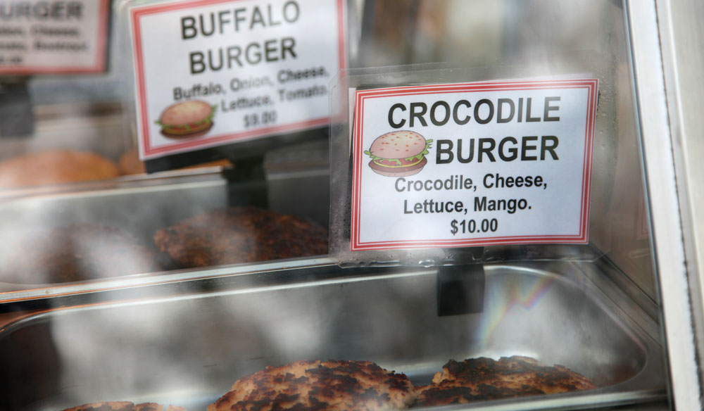 Try something new; a crocodile burger in Darwin.