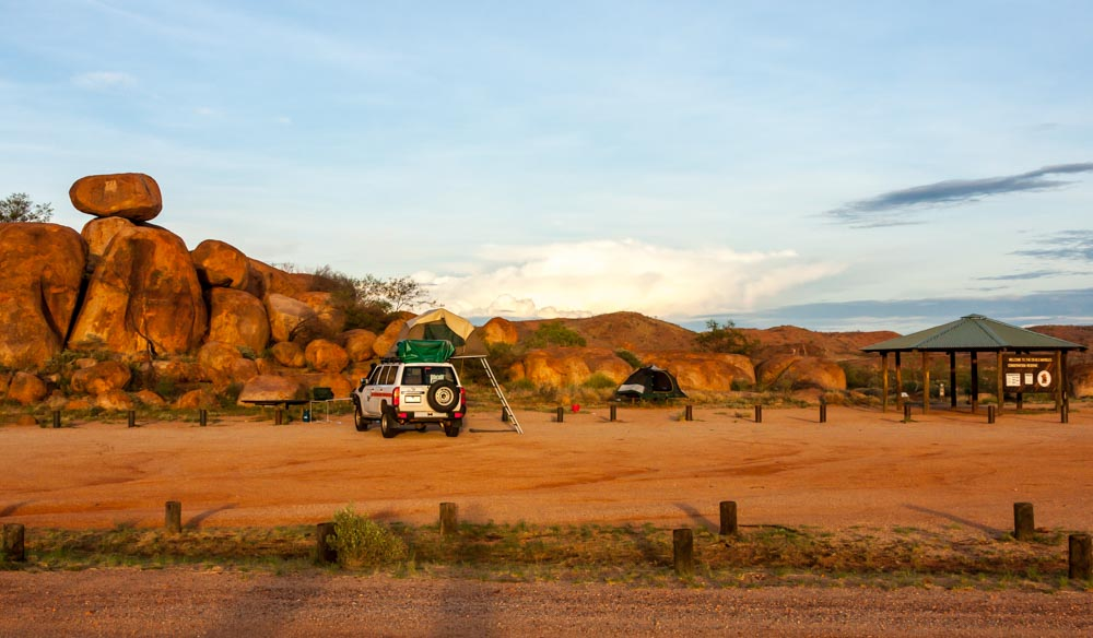 Camp at Devils Marbles Conservation Reserve and watch the boulders change colours with the sunset.