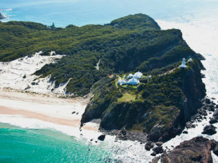 Smoky Cape is the most elevated lighthouse on the east coast, completely surrounded by natural bushland with sweeping coastal views. Credit: Smoky Cape Lighthouse Keepers' Cottages, John Spencer OEH
