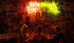 Friends eating at Etsu restaurant under neon lights at night