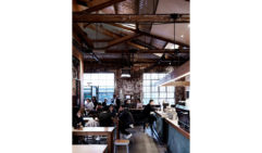 The airy, industrial-chic interiors of Seven Seeds cafe in Carlton (photo: Mark Roper).