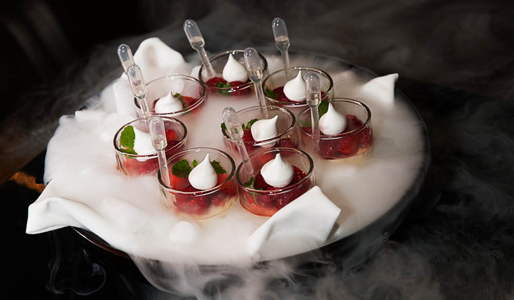 Pannacotta for dessert comes served on a bed of dry ice.