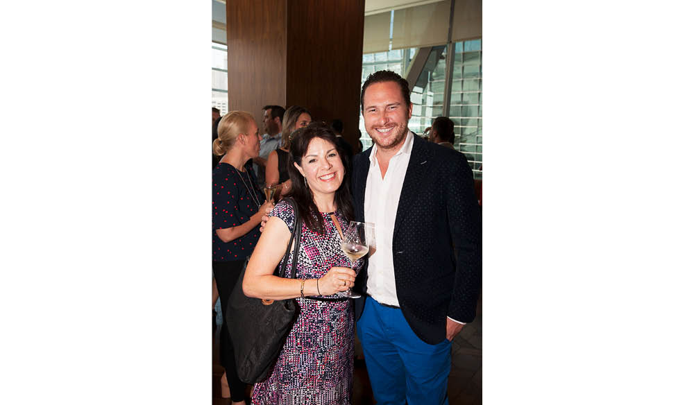 Karena Noble of Voyagers and Stephen Howard of QT Hotels and Resorts arrive to the Champagne Bar.