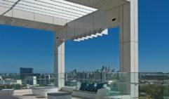 Wall windows grant views of Perth.