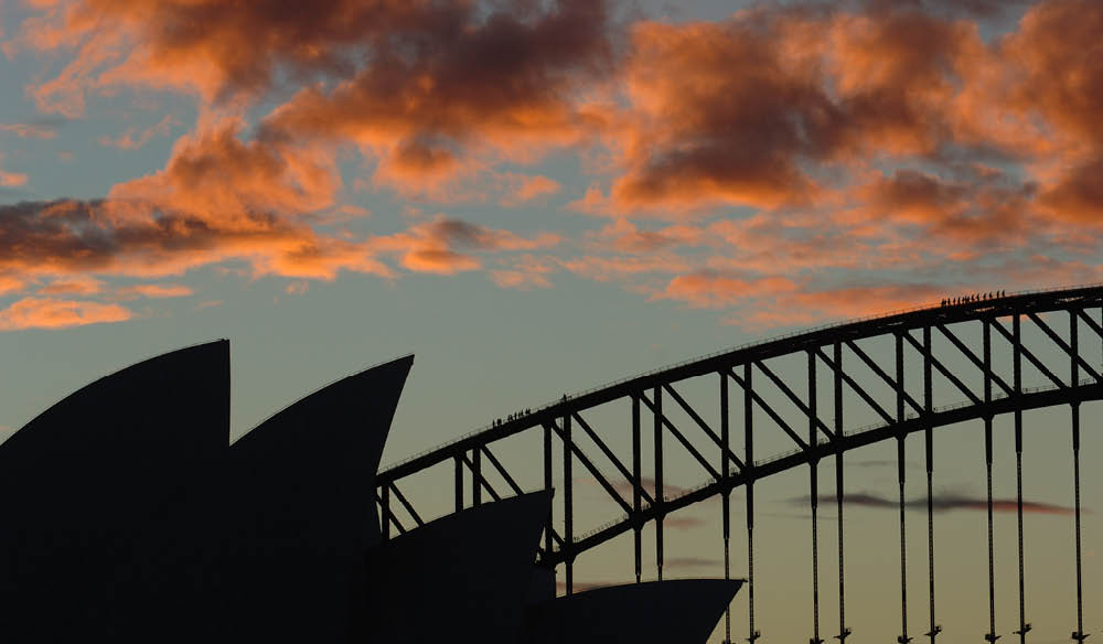 Climbing the bridge at twilight shows off some of Sydney's best sights.
