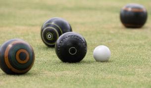 Barefoot lawn bowls at the bowlo