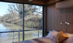Waking to Murray River serenity aboard the Carpe Diem houseboat.