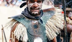 Black cassowary plumes adorn the headdress of a Berlibal performer from Bamaga (photo: Elise Hassey).