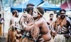 A congratulatory embrace - dance has the power to bring communities together (photo: Elise Hassey).