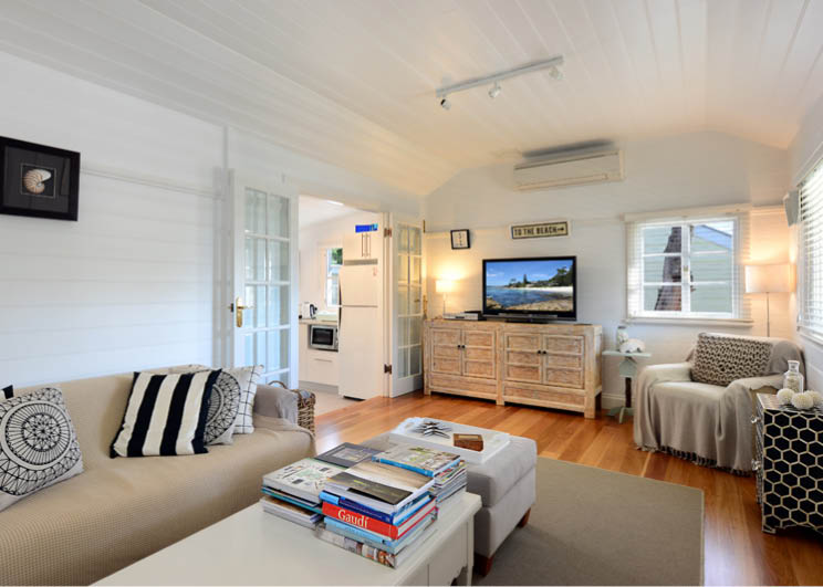 Whalers Cottage at Hyams Beach has everything you need in a beach house... ample coffee table books included.